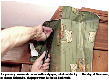 Подпись: As you wrap an outside corner with wallpaper, relief-cut the top of the strip at the corner, as shown. Otherwise, the paper won't lie flat on both walls.