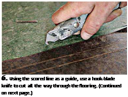 Подпись: 6. Using the scored line as a guide, use a hook-blade knife to cut all the way through the flooring. (Continued on next page.)