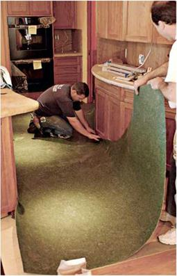 ADHERING AND SEAMING THE FLOORING